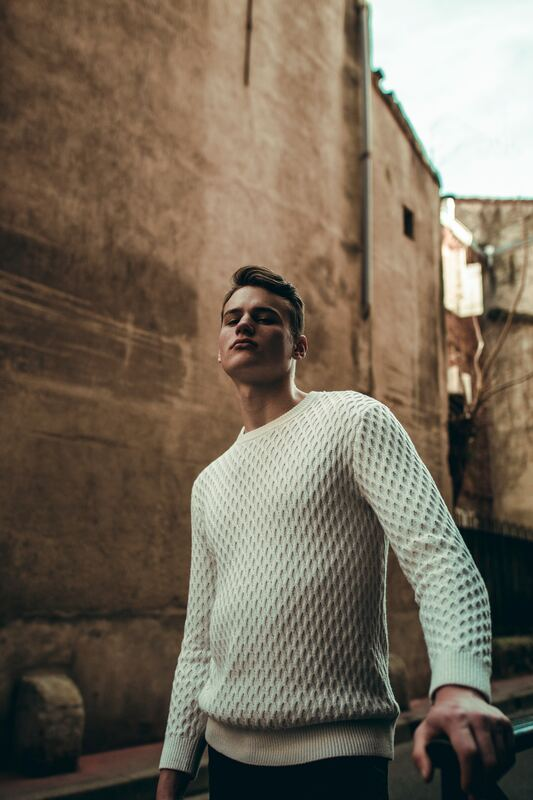 Man wearing cream knit